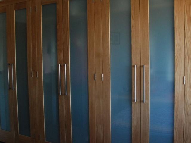 Oak panel bespoke fitted wardrobes