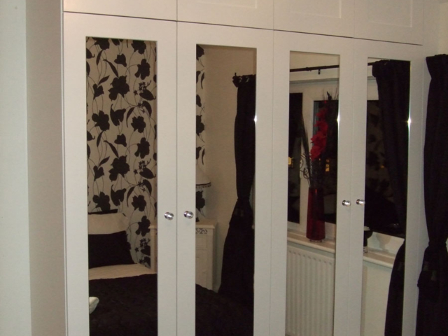 Bespoke mirrored fitted bedroom wardrobes