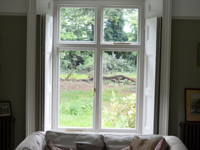 Bespoke wooden windows with shutters