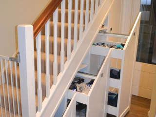 Custom-made fitted staircase storage