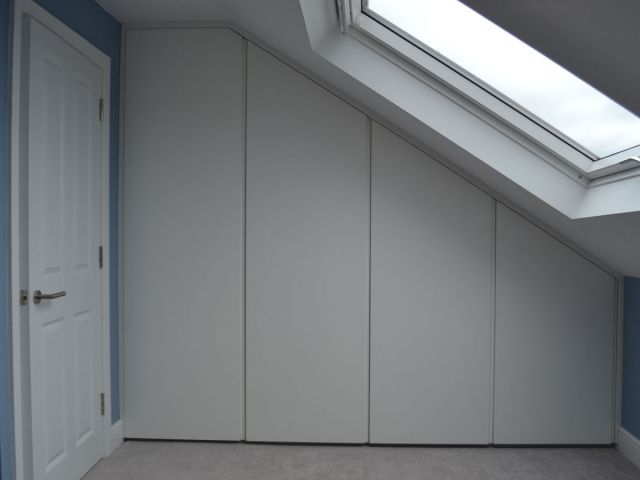 Fitted wardrobes under eves