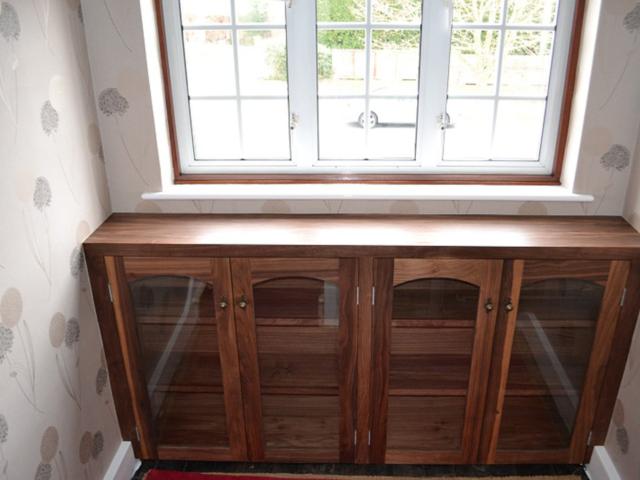 Bespoke walnut glazed cabinet