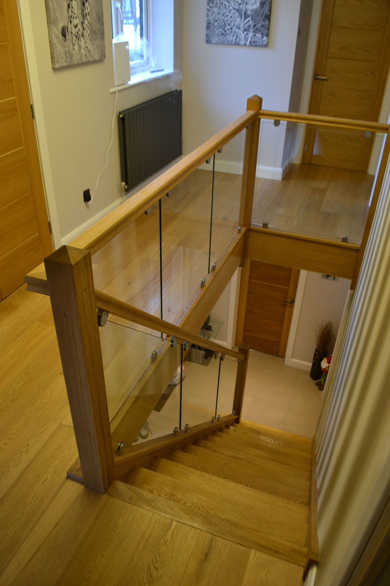 Bespoke staircase with glass balustrade