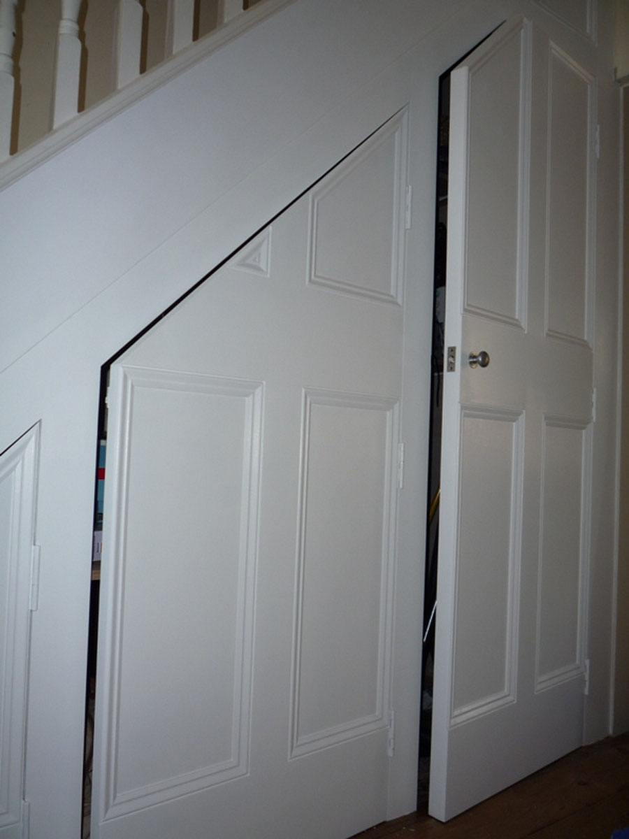 Custom-made fitted under the stairs storage