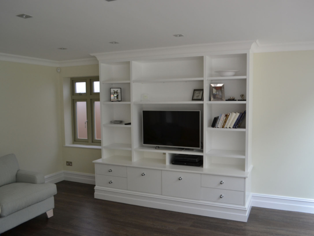 Custom-made fitted living room TV storage units